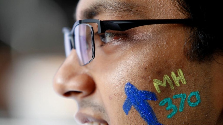 A man with a painted face attend the Day of Remembrance for MH370 event in Kuala Lumpur, Malaysia on Saturday, March 4, 2017. After three years, the hunt for Malaysia Airlines Flight 370 ended in futility and frustration on Tuesday, Jan. 17, 2017, as crews completed their deep-sea search of a desolate stretch of the Indian Ocean without finding a single trace of the plane. (AP Photo/Daniel Chan)