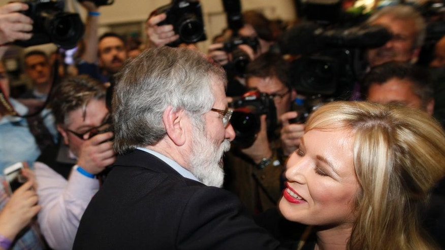 Sinn Fein's Michelle O'Neill is congratulated by party leader Gerry Adams at the count centre in Belfast, Northern Ireland, Friday, March 3, 2017. Michelle O'Neill was elected for Mid Ulster, Irish Nationalists continue to boost their vote in an early election that could shape the fate of the Catholic-Protestant cooperation in Northern Ireland. (AP Photo/Peter Morrison)