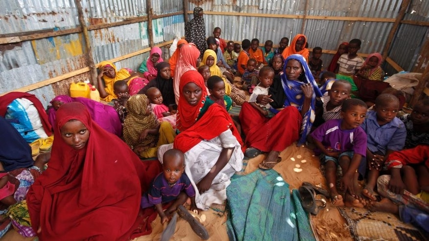 FILE - In this Saturday, Feb. 18, 2017 file photo, displaced Somalis who fled the drought in southern Somalia sit in a camp in the capital Mogadishu, Somalia. Somalia's prime minister said Saturday, March 4, 2017 that 110 people have died from hunger in the past 48 hours in a single region as a severe drought threatens millions of people. (AP Photo/Farah Abdi Warsameh, File)