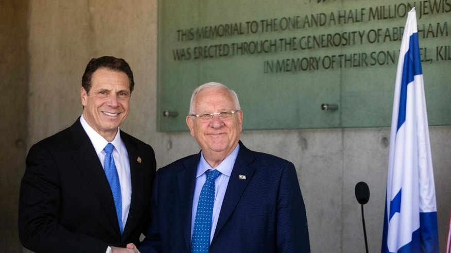The Governor of New York Andrew M. Cuomo, left, and Israeli President Reuven Rivlin shake hands at the Yad Vashem Holocaust memorial, in Jerusalem, Sunday, March 5, 2017. (AP Photo/Dan Balilty)