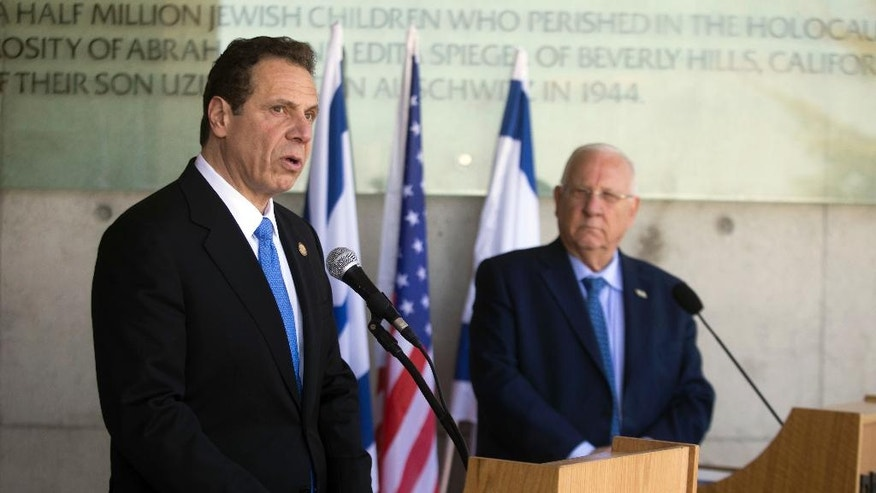 The Governor of New York Andrew M. Cuomo, left, and Israeli President Reuven Rivlin speak to the media at the Yad Vashem Holocaust memorial, in Jerusalem, Sunday, March 5, 2017. (AP Photo/Dan Balilty)