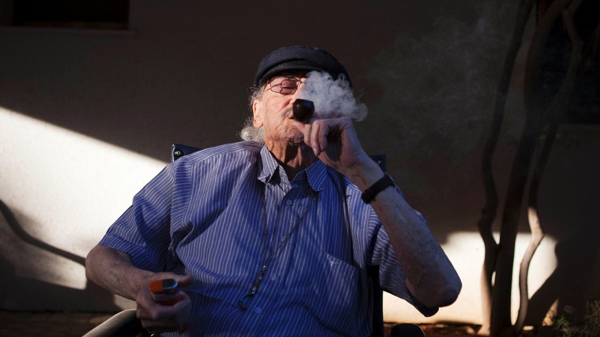 Oct. 30, 2012: Moshe Rute, 80, smokes medical cannabis at the old age nursery home in kibbutz Naan next to the city of Rehovot, Israel. Marijuana is illegal in Israel but medical use has been permitted since the early nineties for cancer patients and those with pain-related illnesses such as Parkinson's, Multiple Sclerosis, and even post-traumatic stress disorder.