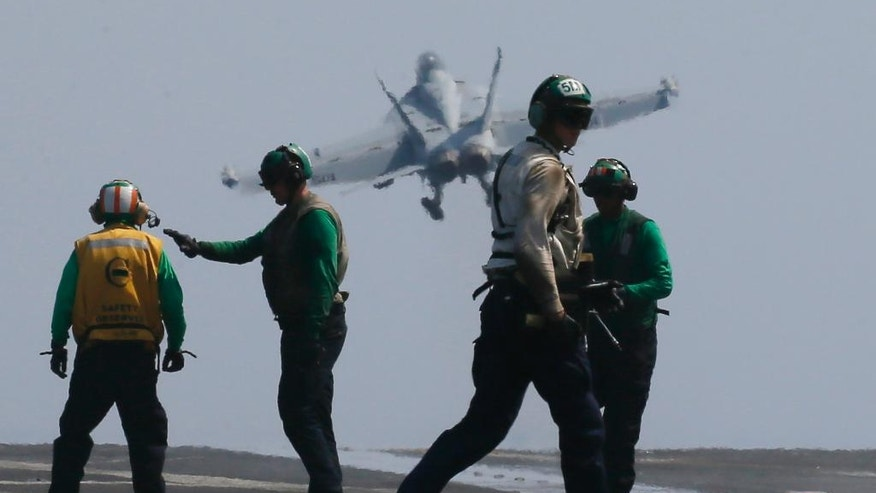 In this Friday, March 3, 2017, photo, a U.S. Navy F18 fighter jet from the U.S. Navy aircraft carrier USS Carl Vinson (CVN 70) for a patrol off the disputed South China Sea Friday, March 3, 2017. The U.S. military took journalists Friday to the carrier on routine patrol off the disputed South China Sea, sending a signal to China and American allies of its resolve to ensure freedom of navigation and overflight in one of the world's security hotspots. (AP Photo/Bullit Marquez, File)