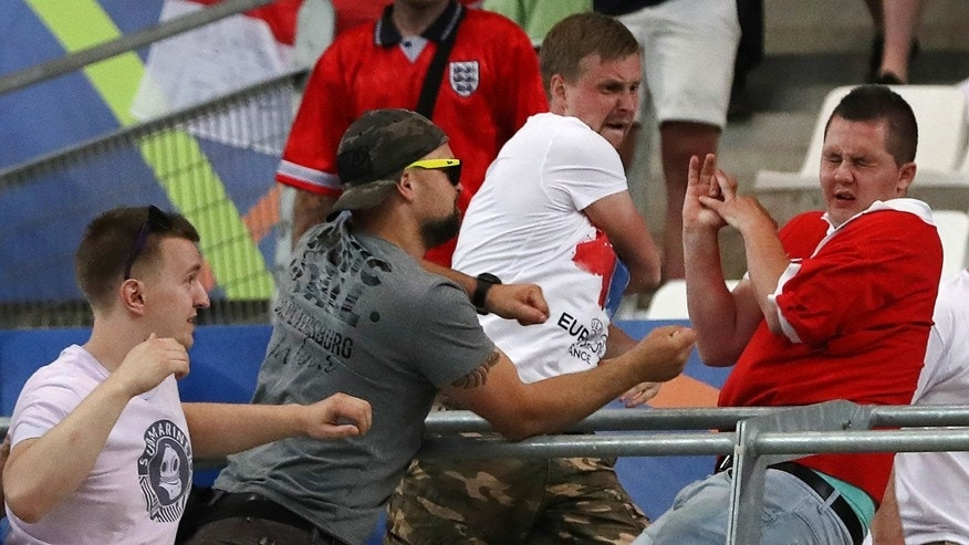 June 11, 2016: Russian supporters attack an England fan at the end of the Euro 2016 Group B soccer match between England and Russia, at the Velodrome stadium in Marseille, France.