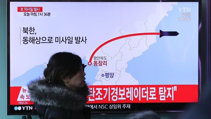 "A visitor walks by the TV screen showing a news program reporting about North Korea's missile firing, at Seoul Train Station in Seoul, South Korea, Monday, March 6, 2017.  North Korea on Monday fired four banned ballistic missiles that flew about 1,000 kilometers (620 miles), with three of them landing in Japan's exclusive economic zone, South Korean and Japanese officials said, in an apparent reaction to huge military drills by Washington and Seoul that Pyongyang insists are an invasion rehearsal.  The letters on the top read "" North Korea, Fire missile."" (AP Photo/Lee Jin-man)"