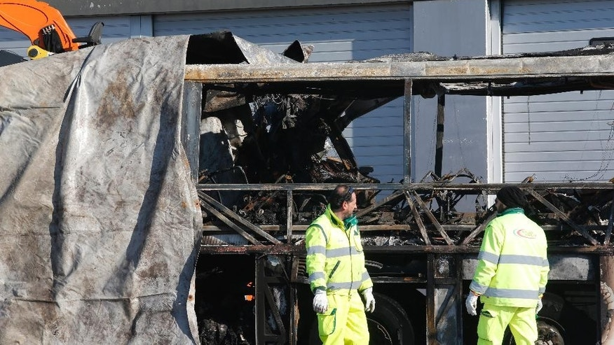 FILE - This  Jan. 21, 2017 file photo shows  the gutted remains of the bus that crashed along the A4 highway in Verona, Italy, Hungarian education authorities said Monday March 6, 2017  the government is seeking to review rules about long school trips in light of a January bus crash in Italy in which 16 people, mostly Hungarian students, were killed.   (AP Photo/Antonio Calanni,file)