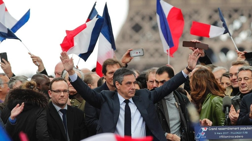 "French conservative presidential candidate Francois Fillon cheers the crowd after delivering his speech during a rally in Paris, Sunday, March 5, 2017. Fillon is urging his supporters not to ""give up the fight"" for the presidency despite corruption allegations dogging him. (AP Photo/Christophe Ena)"