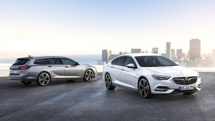 This undated image provided by car manufacturer Opel AG, shows a Opel Insignia Grand Sport, right, and the Insignia Sports Tourer station wagon. The cars will be shown at the Geneva Auto Show in Geneva Switzerland that starts Tuesday March 7, 2017.  Europe's automakers face huge questions: the impact of Britain's decision to leave the European Union, Donald Trump's proposed border tax on imports, the uncertain prospects for electric vehicles. Meanwhile they have to keep selling cars -  in a ferociously competitive market.  (Adam Opel AG via AP)