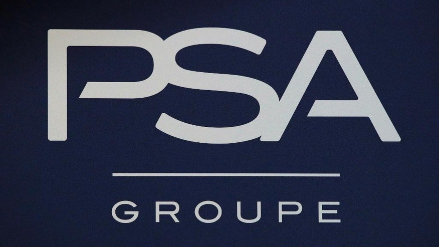 FILE - In this Thursday, Feb. 23, 2017, file photo, the logo of PSA Group is pictured during the presentation of the company's 2016 full year results, in Paris. After billions in losses and years of unsuccessful turnaround attempts in Europe, General Motors decided that a foothold in the world's third-largest auto market isn't worth the drag on its bottom line. The Detroit automaker on Monday, March 6, 2017, announced that it's all but getting out of Europe, selling its Opel and Vauxhall units to French automaker PSA Group. (AP Photo/Christophe Ena, File)