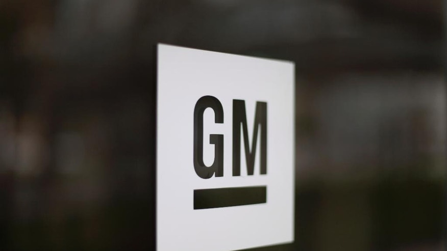 FILE - This Friday, May 16, 2014, file photo, shows the General Motors logo at the company's world headquarters in Detroit. After billions in losses and years of unsuccessful turnaround attempts in Europe, General Motors decided that a foothold in the world's third-largest auto market isn't worth the drag on its bottom line. The Detroit automaker on Monday, March 6, 2017, announced that it's all but getting out of Europe, selling its Opel and Vauxhall units to French automaker PSA Group. (AP Photo/Paul Sancya, File)