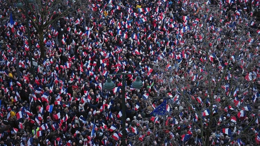 Supporters of conservative presidential candidate Francois Fillon listen during a rally in Paris, Sunday, March 5, 2017. The rally across from the Eiffel Tower is meant to gauge Fillon's remaining support after numerous defections by conservative allies just seven weeks before the first round of the April-May election. Fillon faces corruption charges. (AP Photo/Thibault Camus)