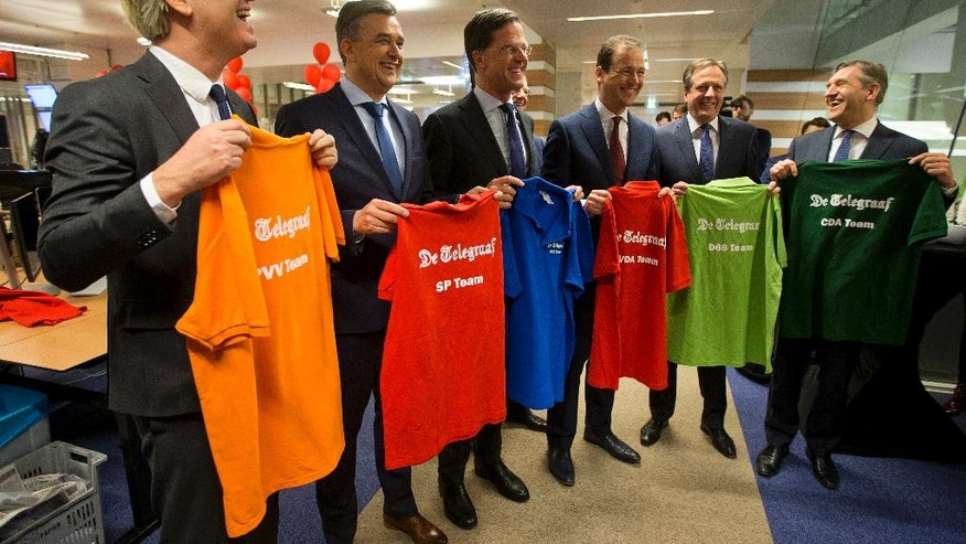 Political party leaders firebrand anti Islam lawmaker Geert Wilders (PVV), Emile Roemer (SP), Dutch Prime Minister Mark Rutte (VVD), Lodewijk Asscher (PVDA), Alexander Pechtold (D66) and Sybrand Buma (CDA), from left to right, pose for a group picture during a visit to De Telegraaf newspaper where the six leaders made a special election edition of the newspaper in Amsterdam, Netherlands, Sunday, March 5, 2017. (AP Photo/Peter Dejong)