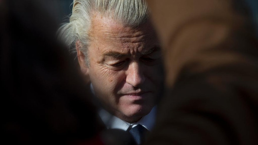 Firebrand anti Islam lawmaker Geert Wilders answers question from the media during an election campaign stop outside De Telegraaf newspaper buildings in Amsterdam Netherlands, Sunday, March 5, 2017. Wilders said he would ban Turkey's entire Cabinet from visiting the Netherlands in coming weeks to prevent ministers campaigning here for a referendum on changing Turkey's constitution. (AP Photo/Peter Dejong)