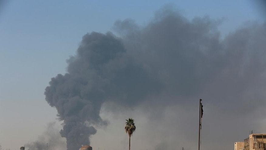 Smoke rises as Iraqi security forces advance during fighting against Islamic State militants in western Mosul, Iraq, Tuesday, March 7, 2017. U.S.-backed Iraqi forces were fighting their way through a government complex in the heart of western Mosul after storming the buildings in an overnight raid, and were facing fierce counterattacks Tuesday from the Islamic State group. (AP Photo/Khalid Mohammed)