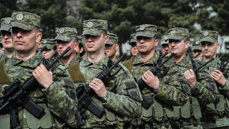 Members of Kosovo Security Force (KSF) attend a ceremony marking the 19th anniversary of Kosovo Liberation Army (KLA) Commander Adem Jashari death, in capital Pristina, Kosovo in this photo taken on Sunday, March 5, 2017.  Kosovo's president asked parliament on Tuesday March 7, 2017, to transform the country's lightly armed security forces into a regular army, a move likely to anger Serbia.(AP Photo)