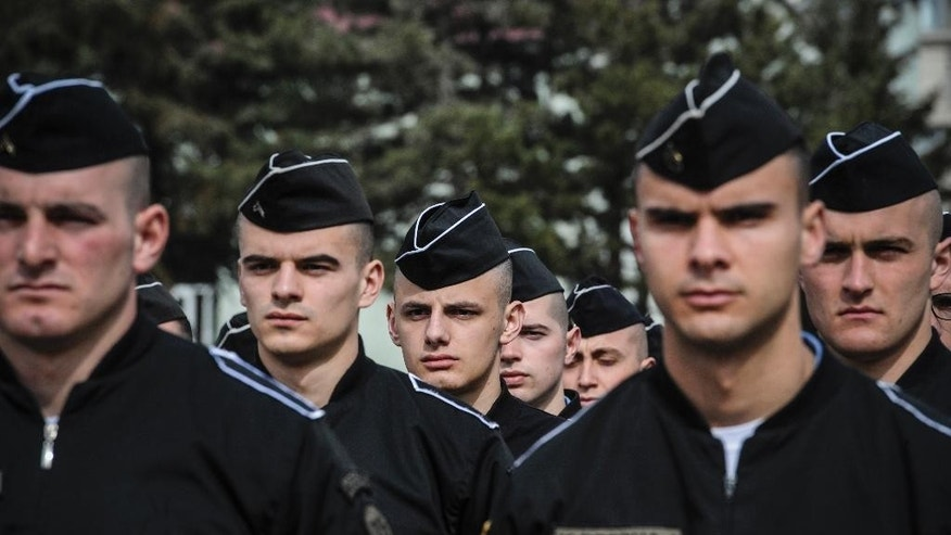 Members of Kosovo Security Force (KSF) attend a ceremony marking the 19th anniversary of Kosovo Liberation Army (KLA) Commander Adem Jashari death, in capital Pristina, Kosovo in this photo taken on Sunday, March 5, 2017. Kosovo's president asked parliament on Tuesday March 7, 2017, to transform the country's lightly armed security forces into a regular army, a move likely to anger Serbia. (AP Photo)
