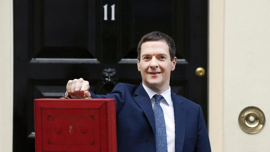 FILE - In this Wednesday, March 16, 2016, file photo, Britain's Chancellor of the Exchequer George Osborne poses for the media with the traditional budget red dispatch box outside his official residence at 11 Downing Street in London. By July, Osborne had  been sacked by new Prime Minister Theresa May following Britain's vote to leave the European Union. The budget on Wednesday, March 8, 107 to be delivered by Osborne's successor, Philip Hammond, is set to be the final spring budget. (AP Photo/Frank Augstein, File)