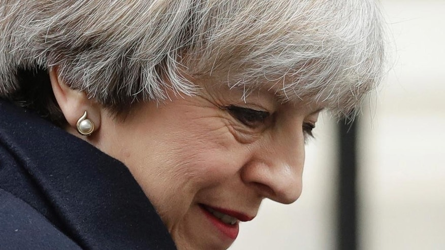 FILE - In this file photo dated Wednesday, March 1, 2017, British Prime Minister, Theresa May leaves 10 Downing Street in London, to attend Prime Minister's Questions at the Houses of Parliament. The British government appears to be facing more opposition to its plans for leaving the European Union, as it seems likely Tuesday March 7, 2017, that Parliament's unelected House of Lords may pass an amendment to require Parliament to approve Britain's exit deal with the EU. (AP Photo/Matt Dunham, FILE)