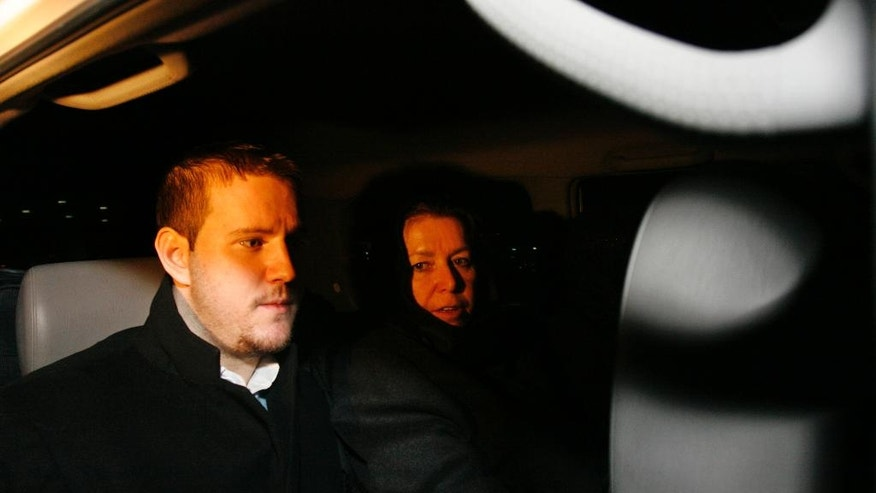 FILE--In this Dec. 18, 2007, file photo Christine Levinson, right, the wife of a missing American former FBI agent and her son, Daniel, sit in a car as they leave Tehran's Imam Khomeini airport upon their arrival in Iran. It's been 10 years since former FBI agent Robert Levinson disappeared while in Iran on an unauthorized CIA mission and his family is still waiting for answers. His family tells The Associated Press they hope the new administration of President Donald Trump will do more to find him. (AP Photo/Vahid Salemi, File)