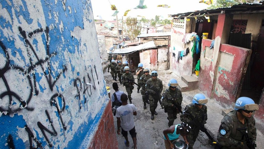 In this Feb. 22, 2017 photo, U.N. peacekeepers from Brazil patrol the Cite Soleil slum in Port-au-Prince, Haiti. They faced no greater threat than a few barking dogs along some of the same streets where pitched gun battles between gangs and U.N. peacekeepers used to be a daily occurrence. (AP Photo/Dieu Nalio Chery)