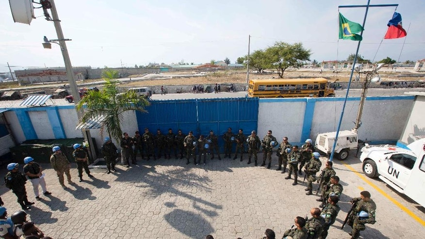"In this Feb. 22, 2017 photo, U.N. peacekeepers from Brazil meet before patrolling in the Cite Soleil slum, in Port-au-Prince, Haiti. The U.N.'s first-ever ""stabilization"" mission came to Haiti in 2004 following a rebellion that had the country on the brink of collapse and ousted then-President Jean-Bertrand Aristide. (AP Photo/Dieu Nalio Chery)"