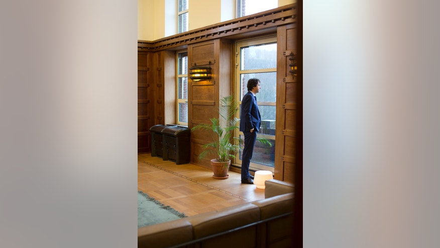 Green Left party leader Jesse Klaver looks out of the window prior to an interview in The Hague, Netherlands, Wednesday, March 8, 2017. (AP Photo/Peter Dejong)