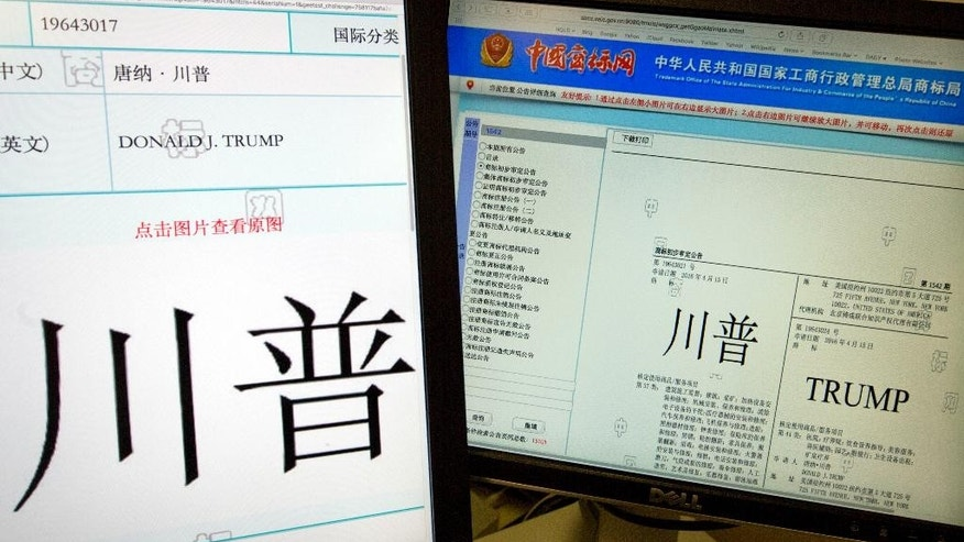 Computer screens showing some of the Trump trademarks approved by China's Trademark office and seen on their website in Beijing, China, Wednesday, March 8, 2017. China has granted preliminary approval for 38 new Trump trademarks, fueling conflict of interest concerns and questions about whether President Donald Trump is receiving special treatment from the Chinese government. (AP Photo/Ng Han Guan)