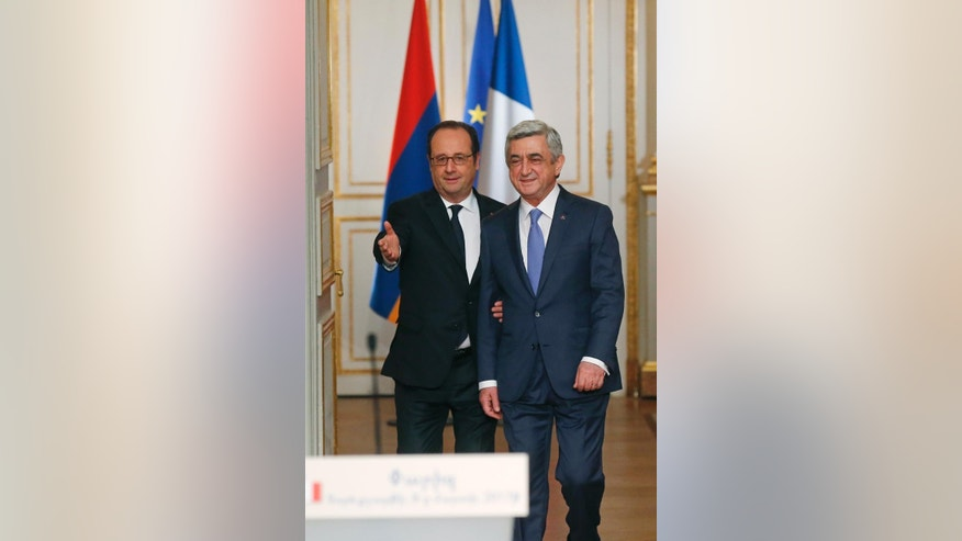 France's President Francois Hollande, left, and Armenia's President Serge Sarkissian arrive for a joint media conference at the Elysee Palace, Wednesday, March 8, 2017. (AP Photo/Michel Euler)