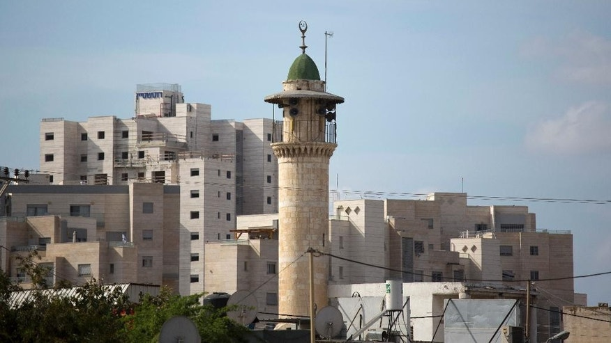 FILE -- In this Nov. 16, 2016 file photo, the minaret of a mosque is seen in Lod, a mixed Jewish Muslim and Christian city in central Israel. On wedneday, March 8, 2017, Israel's parliament passed an initial reading of a bill that would make mosques lower the volume of their call to prayer, amid protests by Arab lawmakers. Arab-Israeli politician Ahmed Tibi tore up the proposal at the Knesset podium Wednesday. The bill still needs to pass several more hurdles. (AP Photo/Ariel Schalit, File)