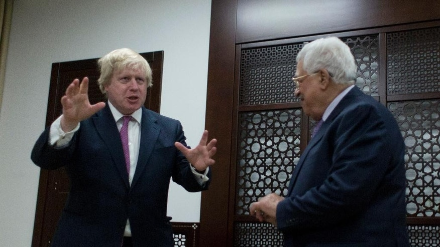 Palestinian President Mahmoud Abbas, right, talks with Britain's Foreign Secretary Boris Johnson during their meeting, in the West Bank city of Ramallah, Wednesday, March 8, 2017. (AP Photo/Nasser Nasser)