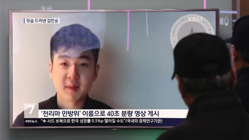 People at a railway station in Seoul, South Korea, watch a TV news program displaying a video in which a man claims to be the son of the slain half brother of North Korea's leader Wednesday, March 8, 2017. The South Korean National Intelligence Service determined the man in the video is Kim Han Sol, whose father, Kim Jong Nam, was killed at an airport in Malaysia last month. (AP Photo/Lee Jin-man)