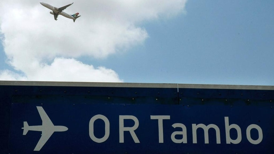 CORRECTS TITLE OF AIRPORT AND THE DATE OF THE INCIDENT FILE - In this Oct. 2006 file photo a plane takes off from Johannesburg's OR Tambo International Airport. South African police are investigating an armed robbery which took place at the airport on Tuesday evening March 7, 2017. (AP Photo/Mujahid Safodien)