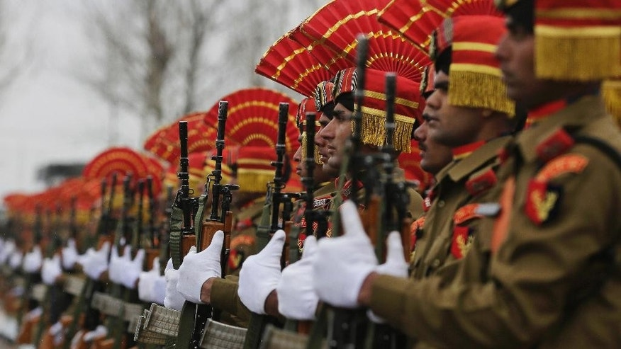 New recruits of the Indian Border Security Force (BSF) salute during their graduation ceremony in Humhama, outskirts of Srinagar, Indian controlled Kashmir, Wednesday, March 8, 2017. A total of 126 recruits formally inducted into the BSF, will join Indian soldiers fighting separatist Islamic guerrillas in Kashmir to help end an insurgency that started in 1989. (AP Photo/Mukhtar Khan)