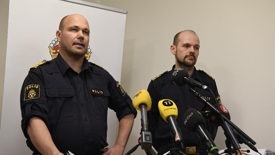 District Police Commissioner Ulf Johansson, left, and Patrik Ungsater police chief Stockholm north attend  a news conference in Stockholm Thursday March 9, 2017. Swedish police say two men in their 20s have been shot dead while sitting in a car in a Stockholm suburb where feuds between criminal gangs fighting over territory have taken place. (Janerik Henrikssson/TT via AP)