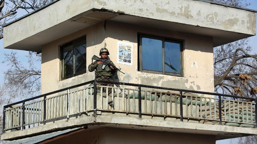 An Afghan soldier stands guard at a military hospital after an attack in Kabul, Afghanistan, Wednesday, March 8, 2017. Afghanistan's Defense Ministry said more than 30 people have been killed in this morning's attack on the military hospital in Kabul. An affiliate of the Islamic State group is claiming responsibility for the attack, which happened in Kabul's heavily guarded diplomatic quarter. (AP Photo/Rahmat Gul)