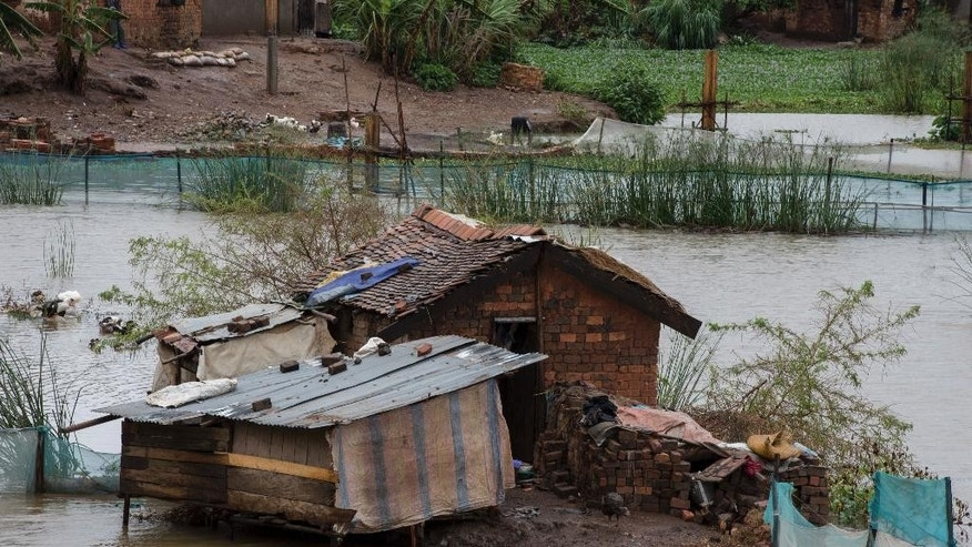 Flood waters are seen in parts of Madagascar's capital, Antananarivo, on Thursday, March 9, 2017. Officials in Madagascar say the death toll from Cyclone Enawo has risen to five and about 10,000 people have left their homes because of storm damage. (AP Photo/Alexander Joe)