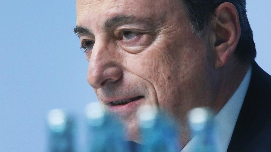 President of the European Central Bank Mario Draghi speaks during a news conference in Frankfurt, Germany, Thursday, March 9, 2017, following a meeting of the ECB governing council. (AP Photo/Michael Probst)