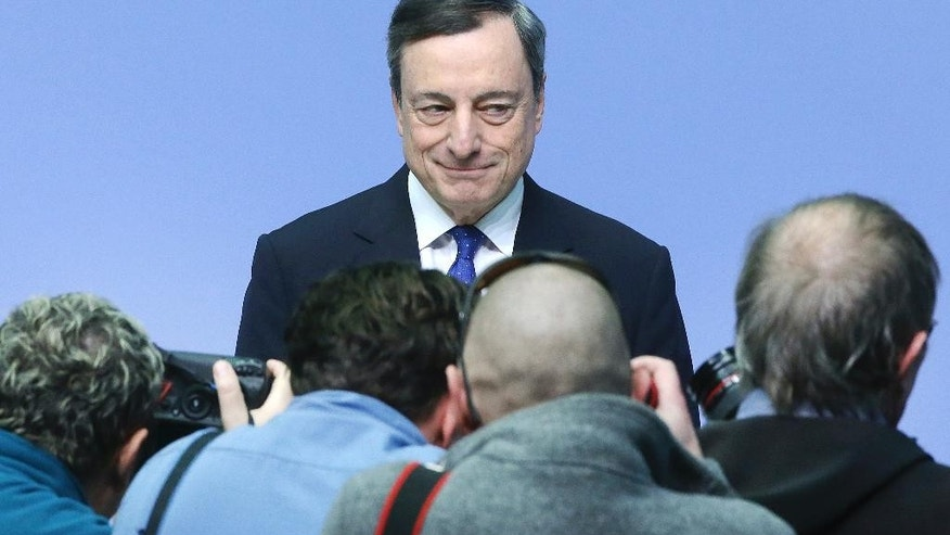 President of the European Central Bank Mario Draghi poses for photographers prior to a news conference in Frankfurt, Germany, Thursday, March 9, 2017, following a meeting of the ECB governing council. (AP Photo/Michael Probst)