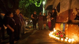 People hold a candlelight vigil in remembrance of the victims of a fire at a children's shelter, outside the morgue where the bodies are being identified in Guatemala City, Wednesday, March 8, 2017. Authorities say at least 22 girls have died after a fire at the children's shelter Virgin of the Assumption Safe Home, which was created to house children who were victims of abuse, homelessness or who had completed sentences at youth detention centers and had nowhere else to go. (AP Photo/Moises Castillo)