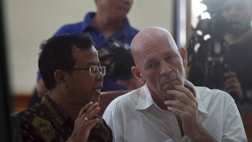 British national and former news correspondent David Fox, right, listens to an Indonesian interpreter during his trial in Bali, Indonesia, Wednesday, March 9, 2017. Indonesian judges sentenced Fox to seven-months in prison for allegedly possessing hashish. (AP Photo/Firdia Lisnawati)