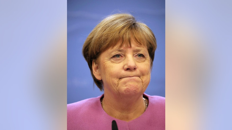 German Chancellor Angela Merkel listens to questions during a media conference at an EU summit in Brussels on Thursday, March 9, 2017. European Union leaders confirmed Donald Tusk for a second term as council president Thursday, overcoming weeks of strong opposition from his native Poland. (AP Photo/Olivier Matthys)