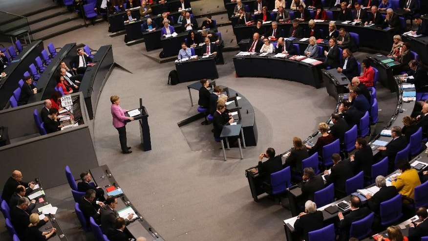 German Chancellor Angela Merkel, standing at lectern, delivers a speech on Europe ahead of an EU summit in Brussels at the German parliament Bundestag in Berlin, Germany, Thursday, March 9, 2017. (AP Photo/Markus Schreiber)