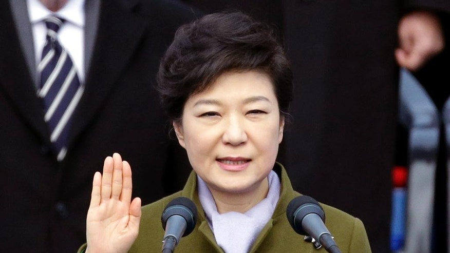 FILE - In this Feb. 25, 2013 file photo, South Korea's new President Park Geun-hye takes an oath during her inauguration ceremony at the National Assembly in Seoul, South Korea. The ouster of President Park by the country's Constitutional Court on Friday, March 10, 2017, ends a power struggle that consumed the nation for months. (AP Photo/Lee Jin-man, File)