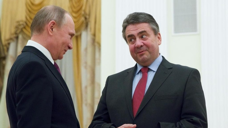Russian President Vladimir Putin, left, and German Foreign Minister Sigmar Gabriel speak during their meeting in the Kremlin in Moscow, Russia, Thursday, March 9, 2017. (AP Photo/Pavel Golovkin, pool)