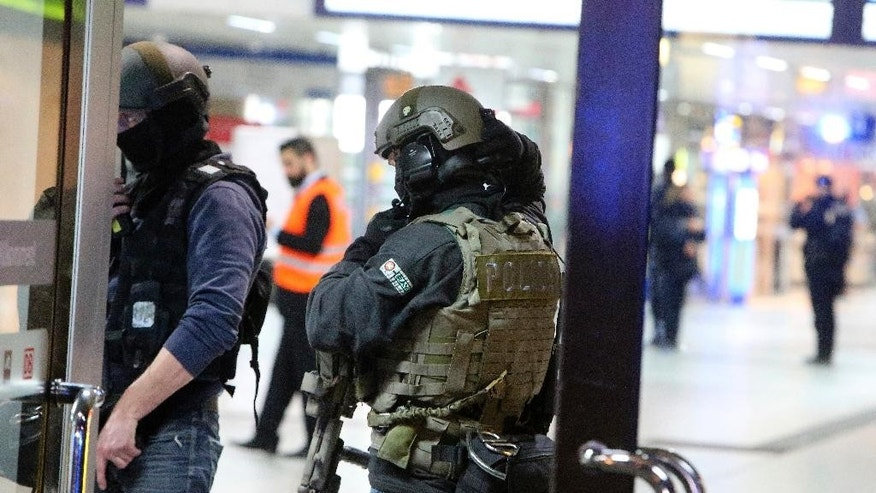 Special police forces stand in the main train station in Duesseldorf, western Germany, Thursday, March 9, 2017 after several people have been injured in an attack with an ax. (David Young//dpa via AP)