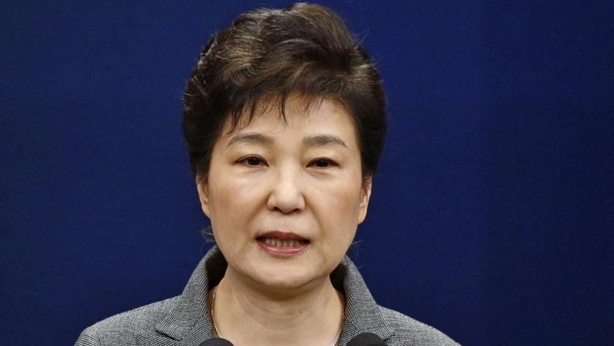 FILE - In this Nov. 29, 2016, file photo, South Korean President Park Geun-hye makes a live televised address in Seoul, South Korea. South Korea's Constitutional Court rules to formally end impeached President Park's rule. (Pool Photo via AP, File)