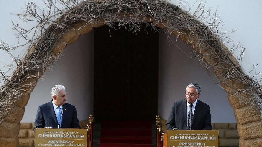 Turkey's Prime Minister Binali Yildirim, left, and Turkish Cypriot leader Mustafa Akinci, speak to the media during a press conference in the Turkish Cypriot breakaway northern part of the divided capital Nicosia, Cyprus, Thursday, March 9, 2017. Yildirim is in the breakaway north part of the island for a one-day visit for talks. (AP Photo/Petros Karadjias)