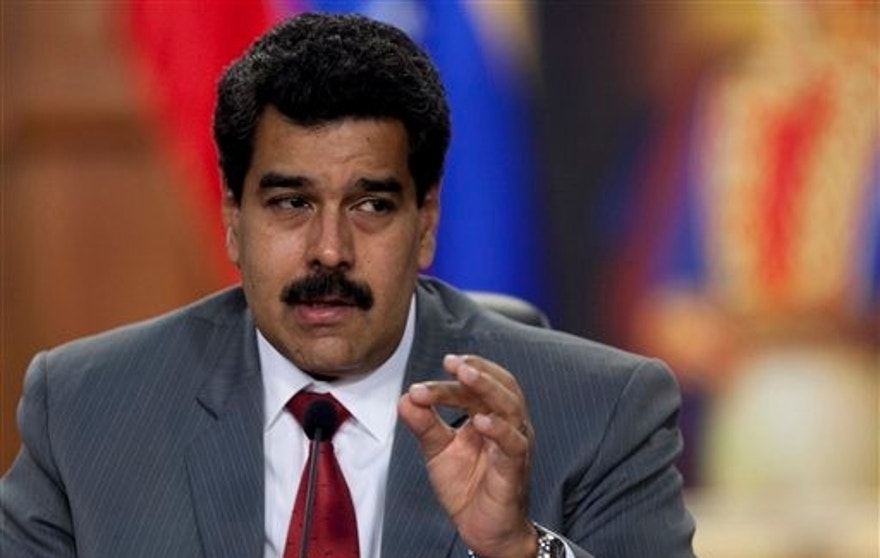 Venezuela's President Nicolas Maduro speaks during a press conference at the Miraflores presidential palace in Caracas, Venezuela, Friday, March 14, 2014. The Venezuelan government is stepping up security operations in Caracas and other cities where demonstrators are blocking streets, avenues and highways. Maduro said that those involved in creating road barricades will be arrested. (AP Photo/Alejandro Cegarra)