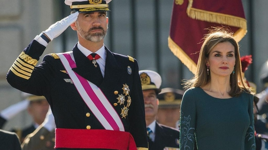 FILE - In this Tuesday, Jan. 6, 2015 file photo, Spain's King Felipe VI, left, and Queen Letizia review troops during the annual Pascua Militar Epiphany ceremony at the Royal Palace in Madrid, Spain. Spain's royals will pay a state visit to Britain in June, the Buckingham Palace said in a statement Friday, March 10, 2017, an announcement that effectively pushes back U.S. President Donald Trump's state visit to autumn at the earliest. (AP Photo/Andres Kudacki, File)
