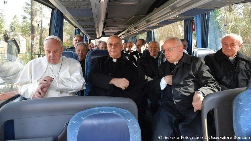 Pope Francis sits on a bus with members of the Roman on their way back to the Vatican at the end of a week long spiritual retreat at the village of Ariccia, near Rome, Friday, March 10, 2017. (L'Osservatore Romano/Pool Photo via AP)